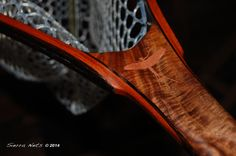 Carved mayfly inlaid with Copper into a Claro Walnut Fly fishing net handle.