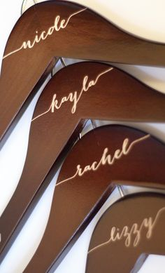 Engraved Mahogany Bridal Party Hangers www.blacklabeldecor.com