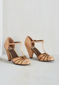 Bold Fashioned Heel. Vintage-inspired elegance meets eye-catching elan in these metallic heels by Bettie Page. #tan #prom #modcloth