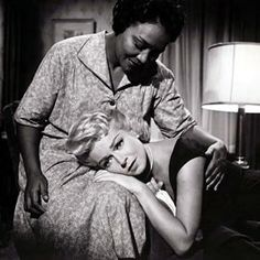 imitation of life... this movie is older than my grandma, but the lesson it is so beautiful. it's about a young bi-racial girl who passes for white & is accepted by people who would normally hate her if they knew the truth. she denies her own mother & hates herself until she learns that no one can truly love you unless you love yourself first <3