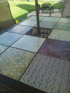 Modge podge scrapbook paper to plain floor tiles....
