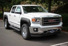 sets of lifted GMC trucks of various vintages and colors Twiiter @GMCGuys