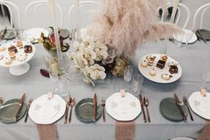 orchids and feather floral arrangements by bespoke Butcher Baker Stylist. / sfgirlbybay