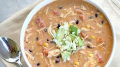 Creamy chicken enchilada chowder with black beans, corn, tomatoes, and cheese. Throw it in the crockpot and forget about it for a couple of hours and come back to delicious comforting soup.