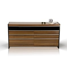 Modrest Rondo Modern Bedroom Dresser VGWCRONDO-DRProduct :  11723Features :Modern Bedroom DresserWalnut wood grain veneer finishFeatures 8 drawers for ample storage spaceQuiet sliding drawersMirror is also availableDimensions :Dresser: W:63