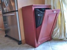A tilt out trash can for the kitchen. A fantastic way to hide a trash can!