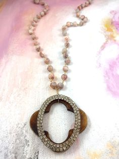 """Finding Rest"" - 1940's rhinestone buckle layered over a wood quatrefoil pendant and hung on pink marble chain"