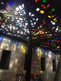 This roof design used by cast iron materials combine with transparency stained glasses led the sunlight trasform into different color of the light. The effect of different color of light cast to interior surface reminds me the stained windows design of Antoni Gaudi's architecture deign La Sagrada Familia in Barcelona of Spain.