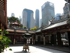 Temple in Singapore surrounded by modern buildings