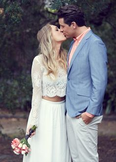 Stunning relaxed Boho wedding, with bride in long sleeve lace bridal separates. Blue and blush wedding colors.