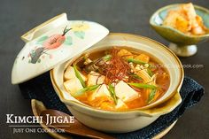 Kimchi Jjigae is a spicy Korean stew made with kimchi, tofu, and mushrooms. Make this dish for the colder months and you'll be sure to stay warm. Best Vegan Recipes, Tofu Recipes, Asian Recipes, Cooking Recipes, Healthy Recipes, Ethnic Recipes, Vegan Dishes, Tasty Dishes, Easy Japanese Recipes