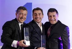 Best restaurant in the world. Head chef Joan Roca, left, accompanied by his brothers Jordi Roca, center, and Josep Roca, right,  pose for the photographers with their trophies afte...