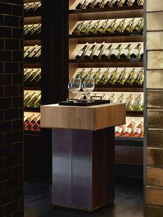 Interior Designer Profile - Carlisle Design Studio. Wine room with concealed lighting