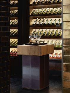 Interior Designer Profile - Carlisle Design Studio. Wine room with concealed…