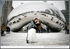 Rita and David's winter wedding - A kiss in front of Cloud Gate in Chicago's Millennium Park www.richchapmanphoto.com