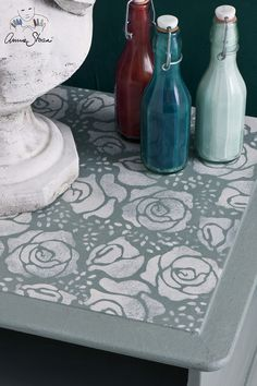 The Roses Stencil from the Annie Sloan Stencil Collection on top of a small side table