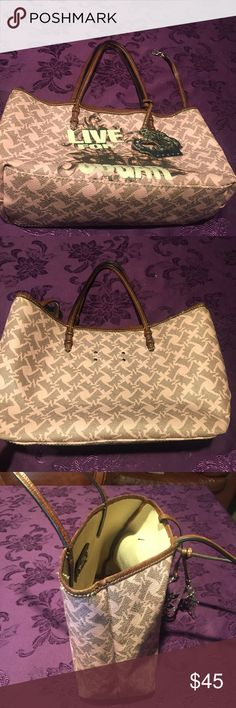 Juicy Couture purse 15 inches wide 9 1/2 in. Long. Juicy Couture purse 15 inches wide 9 1/2 in. Length. Strap is 22inches long. It has a strap to hold keys and a hanging silver juicy Couture and crown hanging piece. Juicy Couture Bags Totes