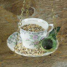 Encourage your feathered friends to stay a while with a bird feeder like this sweet, upcycled teacup.