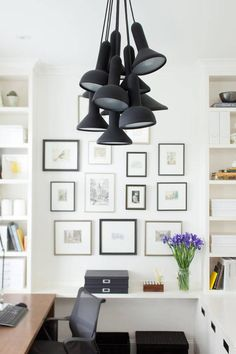 The playful utilitarianism of the Torch Light fixture counters the plain white of the office background, leaving the matte black finish to r...