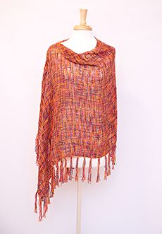 Homecoming Trunk Shows - Tweed is on trend and especially hot this season, and we are bringing it to you in this lightweight loosely knit poncho. Gorgeous, soft and on trend, these ponchos are perfect to wear with a simple shirt, or layer it up for those chillier days. Either way, you'll be looking fabulous in this one-size fits all piece. Available in Black and White or Berry tweed options.    - One Size fits most  - Rayon   - Hand Wash/Dry Clean  - Imported $43.00 www.cwickline.shophts.com