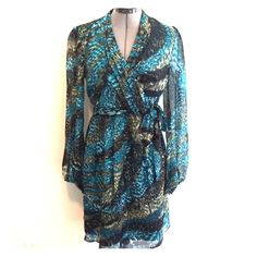 """NWOT Laundry Silk Dress NWOT Beautiful silk dress by Laundry. Green and Turquoise. Size 4. Fully lined body with sheer sleeves. Hidden side zipper. Faux wrap with adjustable self tie at waist for slimming fit. Approx 35"""" shoulder to hem Laundry by Shelli Segal Dresses"""