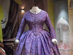 1861-65 purple figured silk dress. Musée de la Mode et de la Dentelle, Brussels. Photo by Cristoph Houbrechts Vanhoorne.