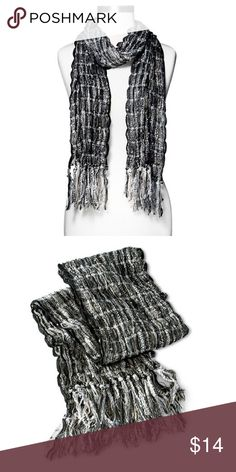 Scarf Textural and stylized, the Xhilaration® Slub Scarf with Fringe - Black/Grey is a beautiful choice for any fashion-forward lady. This versatile accessory can be worn in a multitude of different ways, whether you prefer to let it hang loose or opt for knotting it artfully at the neck. Featuring a uniquely textural knit, a lightweight construction and swaths of distressed fringe decorating each end. Accessories Scarves & Wraps