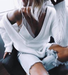 white cableknits + distressed denim
