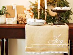 Make a Hand-Painted Burlap Table Runner! Step-by-Step Guide: http://www.hgtv.com/entertaining/how-to-make-a-hand-painted-burlap-table-runner/index.html?soc=hpp