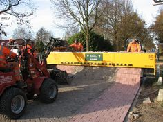 Tiger-Stone Machine for Roads - I wonder if they make patios