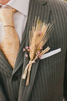 rustic wheat boutonniere for groom / http://www.deerpearlflowers.com/wheat-wedding-decor-ideas/
