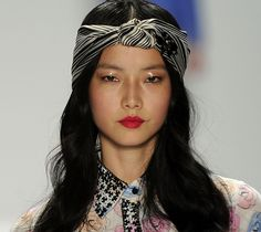 Turbans    Scarf headwraps and turbans were all over the runway at Karen Walker and Anna Sui. Luca Luca has all your spring beauty trends in one place with the turban knotted scarf headwrap, dewy eyes and bright lip.