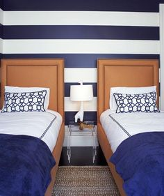 navy and orange bedroom, twin beds, orange headboards, navy could be subbed with teal for a cute look.