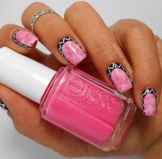 Pink marbled nails trimmed with black