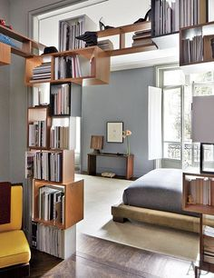 n fashion designer Stefano Pilati's Paris apartment, furniture designer Martino Gamper created the openwork shelving between the master bedroom and the smoking room.