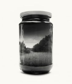 """After becoming a father two years ago, Finnish photographer Christoffer Relander started feeling nostalgic about his own childhood. He began photographing landscapes that reminded him of growing up in rural Finland, and using double-exposure photography to fit these locations inside jars for his ongoing project Jarred & Displaced. """"I grew up in the countryside and nature has always been close,"""" he says. """"I used to play outside a lot, and these environments remind me of this other world."""""""