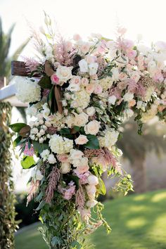 Ivory & Pink Floral Ceremony Décor | Photography: Laurie Bailey Photography. Read More:  http://www.insideweddings.com/weddings/oceanfront-wedding-ceremony-classic-romantic-ballroom-reception/854/