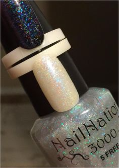 The need for a holographic topper filled to capacity with aqua green to blue iredescent micro squares is now FILLED! This is a fantastic topper for layering over almost any shade and over french manis and even layered on its on for a clean see thru shimmer of holo and sparkles! Shown 2 coats alon...