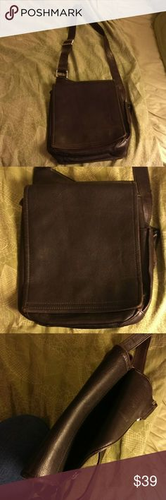 """Gorgeous Latigo chocolate leather crossbody bag Beautiful, supple thick chocolate brown leather satchel with lots of pockets. Measures 9""""x8.5""""x2.7"""" Back zip pocket, back slip in pocket for small tablet, large interior space with zip pocket, front zip, slide in & credit card pockets in front under flap. Fabric interior with minor discoloration. Front zip pocket fabric has tiny tear, never noticed in years of use. Gorgeous, practical & lots of life left. Bags Crossbody Bags"""