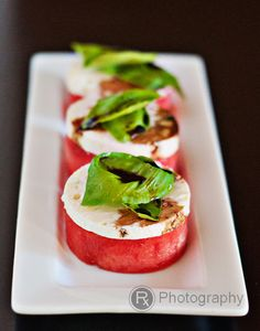 Watermelon and feta salad with basil and balsamic reduction. This would be nice with mint too