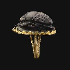 """An Egyptian Steatite Scarab, Third Intermediate period, Dynasty XXII, reign of Shoshenq I, 945-924BC. ---- Sheshonq I was the first ruler of the 22nd Dynasty. He belonged to a family of Libyan chiefs that had been living in Egypt for generations and his reign ushered in the Libyan dynasties of the Third Intermediate Period. He is best known as the Pharaoh """"Shishak"""" of the Old Testament who invaded the newly divided kingdoms of Israel and Judah (1 Kings 14:25; and 2 Chronicles 12:1-12)."""
