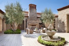 Northern Italian style villa surrounded by an inviting desert oasis
