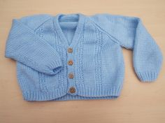 Hand knitted baby boys cardigan in blue with wooden buttons 1 - 2 years £10.00