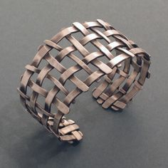"The bracelet alone is very impressive, but it is also well suited in combination with other pieces from the ""Lattice"" collection. The light, open design and partial darkness of the silver make this bracelet a classic and exciting piece of jewellery."