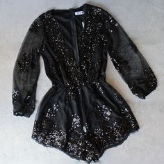 - Sequin mini romper - Deep plunge v-neckline - Mesh overlay - Sequin embellishment - Long, sheer sleeves with elastic cuffs - Partially lined - Elasticized waist - 100% polyester - Length of size S s