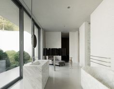 Marble vanity facing the exterior windows / ceiling mount mirror / free standing marble tub / Fayland House by David Chipperfield