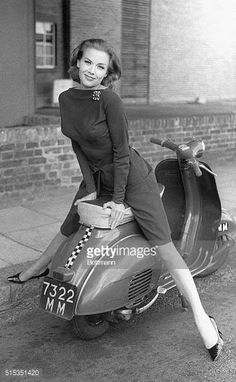 Actress Honor Blackman poses on a moped in a slender cocktail dress on the set of The Avengers television program in London. Blackman plays the role of Cathy Gale in the popular action series. Get premium, high resolution news photos at Getty Images Vespa Girl, Scooter Girl, Vespa Lambretta, Vespa Scooters, Car Girls, Pin Up Girls, Motos Vespa, Chicks On Bikes, Vintage Street Fashion