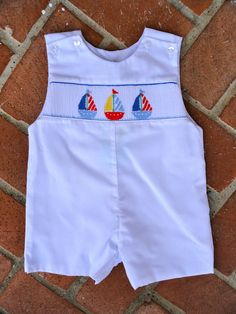 Smocked Sailboat Jon Jon - adorable on the beach! Would allow the rest of the family to introduce color!