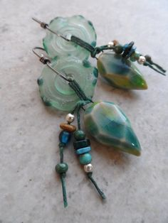 Gorgeous faceted clay charms, expertly handcrafted by Gaea, are perfectly paired together with lampwork criffles (made by Kimberly at Numinosity
