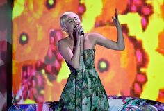 Miley Cyrus rocks at 2014 World Music Awards in a strapless gown while performing at the stage